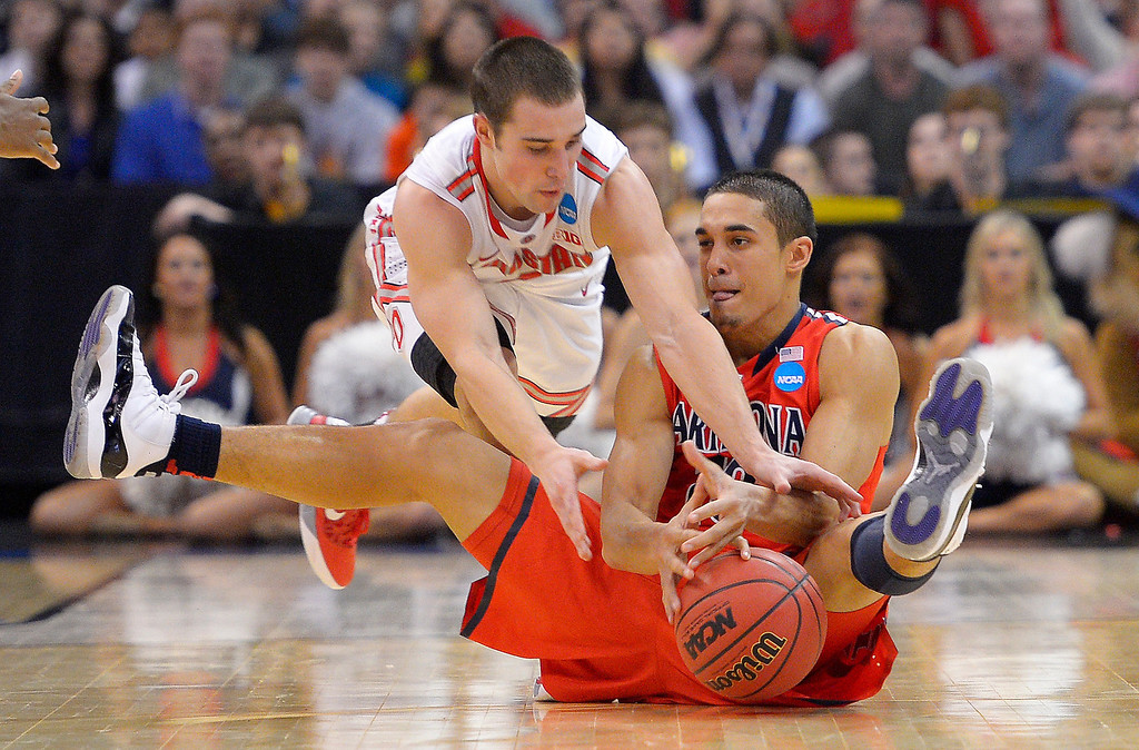 . Ohio State guard Aaron Craft, left, and Arizona guard Nick Johnson scramble for the ball during the second half of a West Regional semifinal in the NCAA men\'s college basketball tournament, Thursday, March 28, 2013, in Los Angeles. Ohio State won 73-70. (AP Photo/Mark J. Terrill)