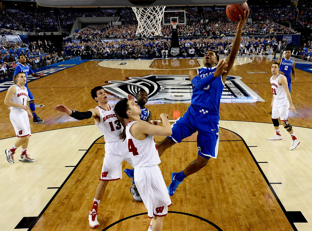 . ARLINGTON, TX - APRIL 05: Andrew Harrison #5 of the Kentucky Wildcats takes a shot as Bronson Koenig #24 of the Wisconsin Badgers defends during the NCAA Men\'s Final Four Semifinal at AT&T Stadium on April 5, 2014 in Arlington, Texas. (Photo by Chris Steppig-Pool/Getty Images)