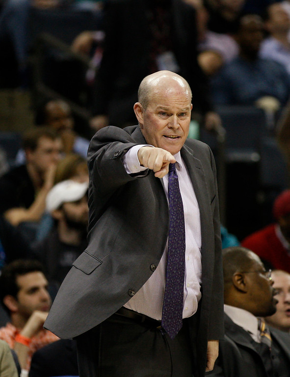. Charlotte Bobcats  coach Steve Clifford directs his team as they play the Denver Nuggets during the second half of an NBA basketball game in Charlotte, N.C., Monday, March 10, 2014. Charlotte won 105-98. (AP Photo/Nell Redmond)