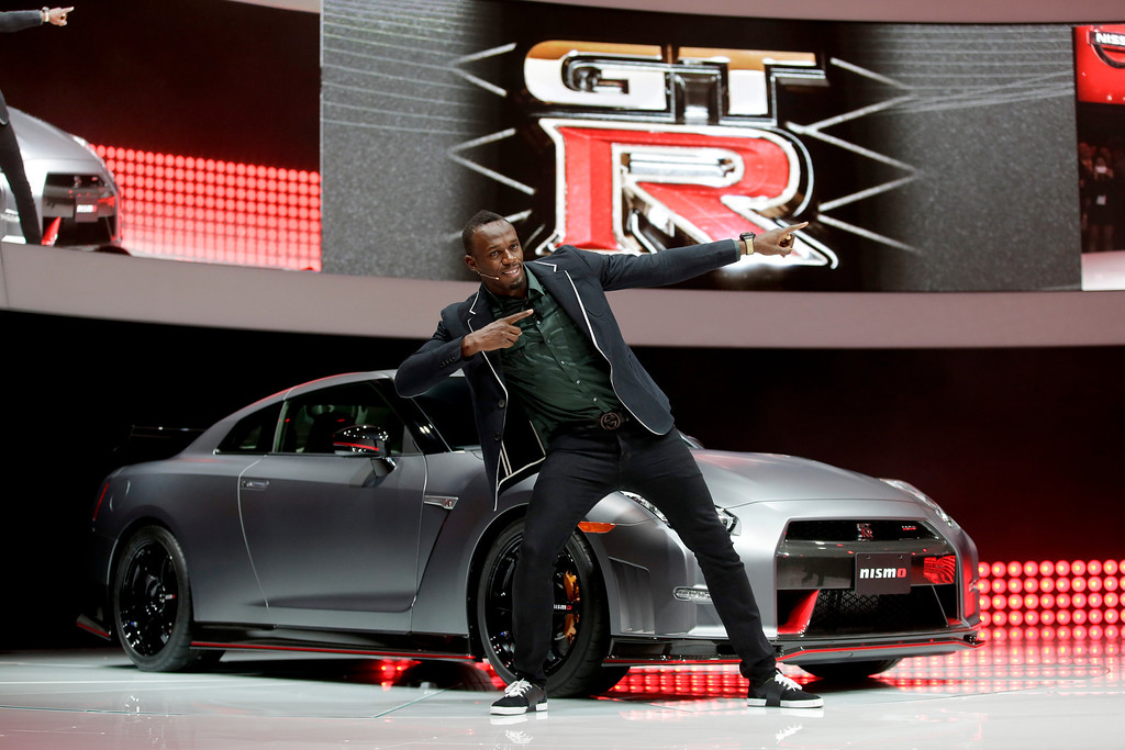 . Olympic gold medalist, Usain Bolt poses in front of the the 2015 Nissan GT-R is debuted at the Los Angeles Auto Show in Los Angeles, Wednesday, Nov. 20, 2013. (AP Photo/Chris Carlson)