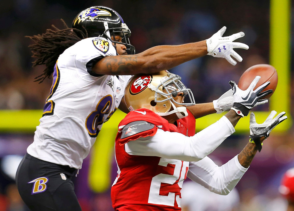 . San Francisco 49ers defensive back Chris Culliver (R) breaks up a pass intended for Baltimore Ravens wide receiver Torrey Smith during the second quarter in the NFL Super Bowl XLVII football game in New Orleans, Louisiana, February 3, 2013. REUTERS/Jeff Haynes