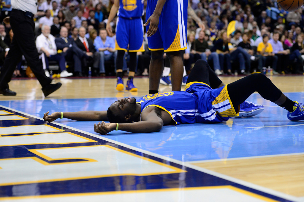 . Golden State Warriors small forward Draymond Green (23) is slow to get up in the third quarter. The Denver Nuggets took on the Golden State Warriors in Game 5 of the Western Conference First Round Series at the Pepsi Center in Denver, Colo. on April 30, 2013. (Photo by AAron Ontiveroz/The Denver Post)