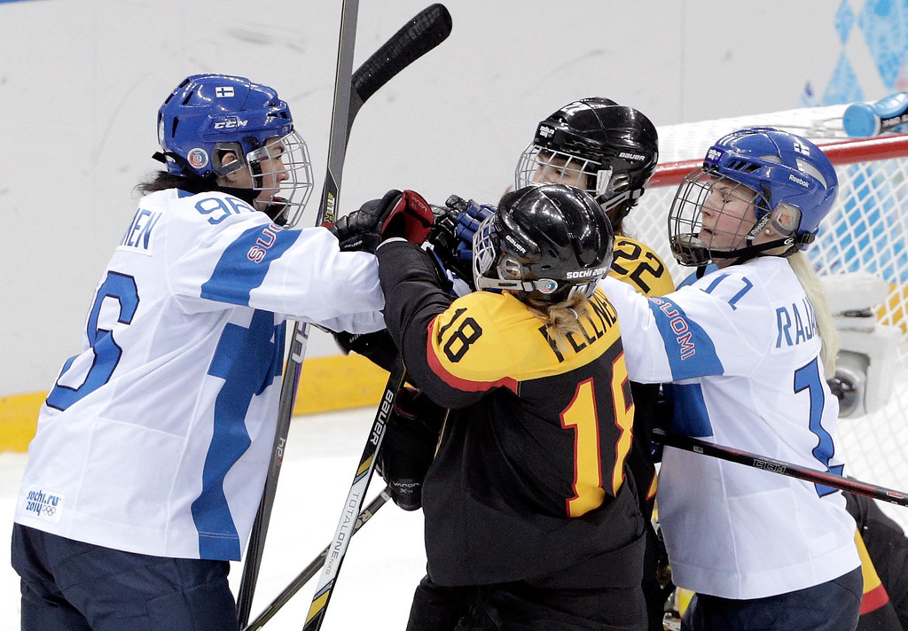. Emma Nuutinen #96 and Annina Rajahuhta #11 of Finland push Kerstin Spielberger #22 and Susanne Fellner #18 of Germany in the second period during the Women\'s Ice Hockey Classification game on day nine of the Sochi 2014 Winter Olympics at Bolshoy Ice Dome on February 16, 2014 in Sochi, Russia.  (Photo by Adam Pretty/Getty Images)