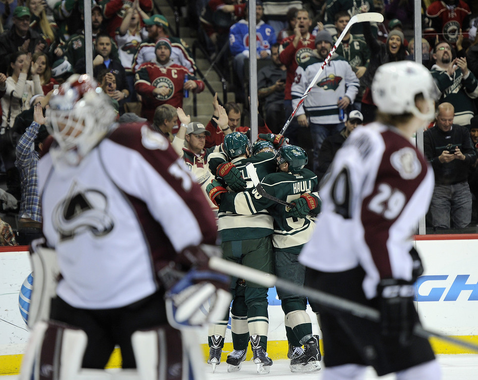 . Dany Heatley #15, Nino Niederreiter #22 and Erik Haula #56 of the Minnesota Wild celebrate a goal by Heatley as Jean-Sebastien Giguere #35 and Nathan MacKinnon #29 of the Colorado Avalanche look on during the second period of the game on November 29, 2013 at Xcel Energy Center in St Paul, Minnesota. (Photo by Hannah Foslien/Getty Images)