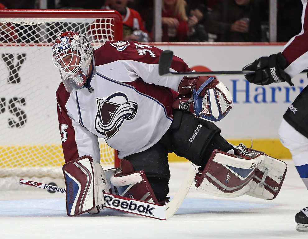 . CHICAGO, IL - DECEMBER 27: Jean-Sebastien Giguere #35 of the Colorado Avalanche reacts after a goal is scored by the Chicago Blackhawks at the United Center on December 27, 2013 in Chicago, Illinois. The Blackhawks defeated the Avalanche 7-2.  (Photo by Jonathan Daniel/Getty Images)