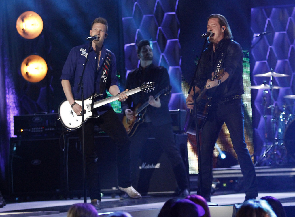 """. Brian Kelley, left, and Tyler Hubbard of Florida Georgia Line perform at CMT \""""Artists of the Year\"""" show held at the Music City Center on Tuesday, Dec. 3, 2013, in Nashville, Tenn. (Photo by Wade Payne/Invision/AP)"""