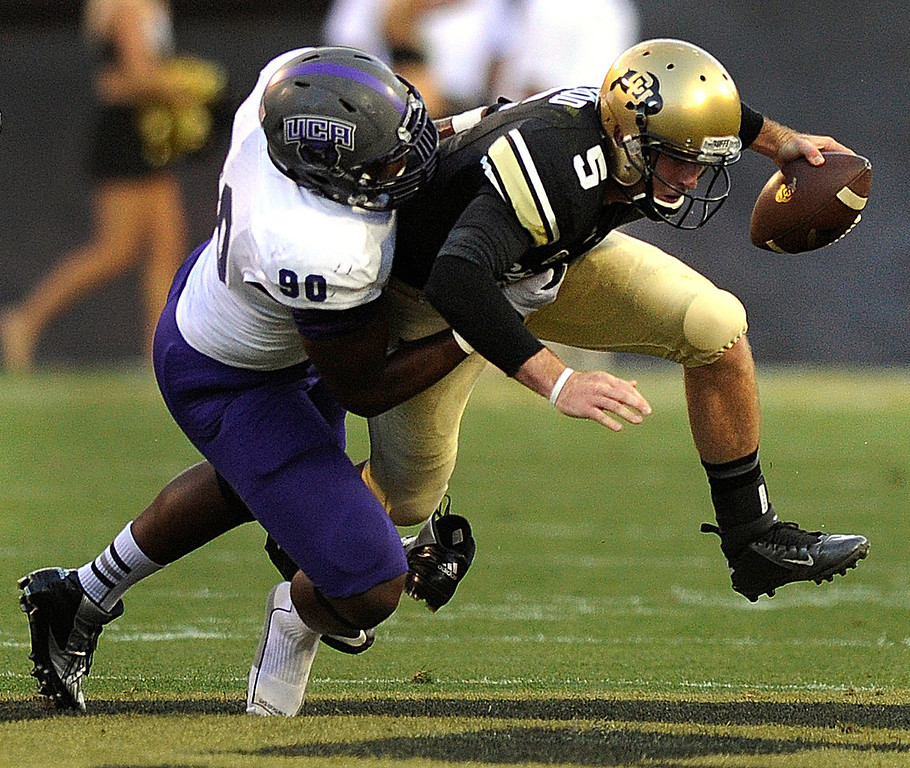. BOULDER, CO. - SEPTEMBER 76: Bears\' defensive end Jonathan Woodard (90) brought down CU quarterback Connor Wood (5) in the first quarter. The University of Colorado football team hosted Central Arkansas at Folsom Field Saturday night, September 7, 2013. Photo By Karl Gehring/The Denver Post