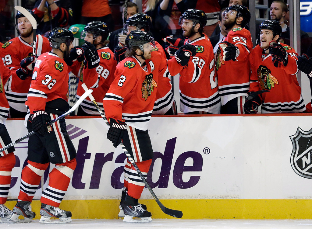 . Chicago Blackhawks defenseman Duncan Keith (2) celebrates with his teammates after scoring a goal against the Los Angeles Kings during the first period in Game 5 of the NHL hockey Stanley Cup playoffs Western Conference finals, Saturday, June 8, 2013, in Chicago. (AP Photo/Nam Y. Huh)