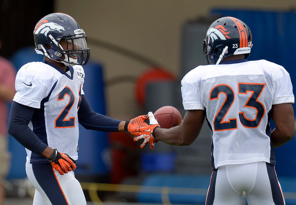 . Denver Broncos free safety Rahim Moore (26) gives the football to Quentin Jammer (23) during practice September 1, 2013 at Dove Valley. (Photo by John Leyba/The Denver Post)