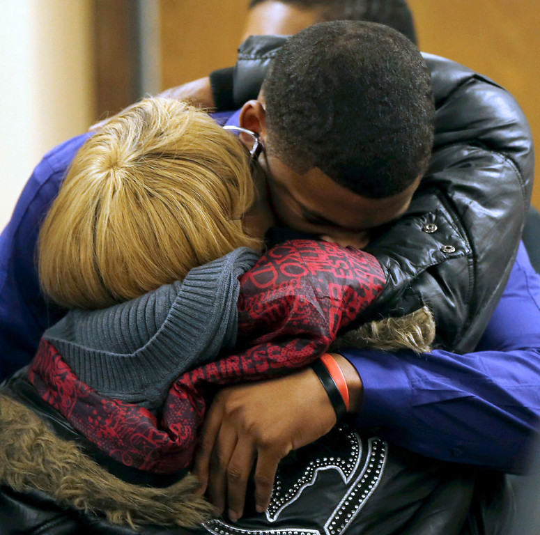 . Ma\'lik Richmond, top, hugs his mother Daphne Birden, after closing arguments were made on the fourth day of the juvenile trial for Ma\'lik and co-defendant Trent Mays on rape charges on Saturday, March 16, 2013 in Steubenville, Ohio. The pair are accused of raping a 16-year-old West Virginia girl in August 2012.  (AP Photo/Keith Srakocic, Pool)