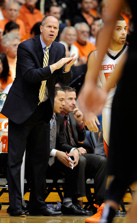 . Colorado head coach Tad Boyle makes a call during the second half of an NCAA college basketball game against Oregon State in Corvallis, Ore., Sunday, Feb. 10, 2013. Colorado won 72-68. (AP Photo/Greg Wahl-Stephens)