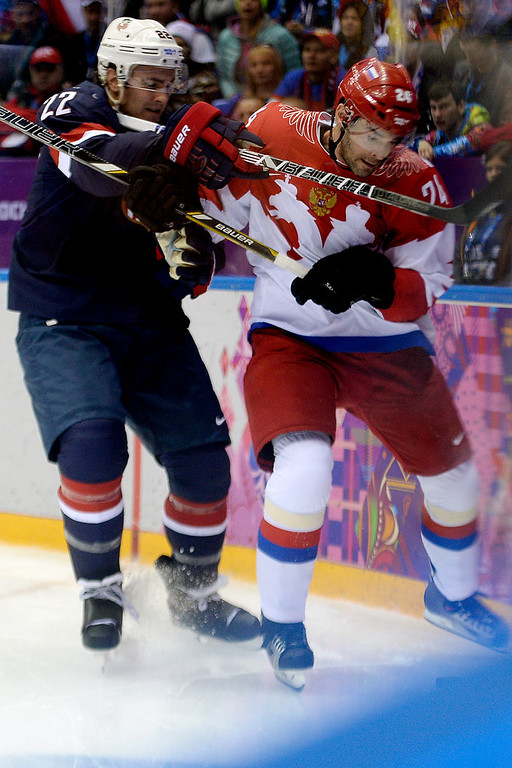 . Kevin Shattenkirk (22) of the U.S.A. checks Alexander Popov (24) of the Russia during the second period of men\'s hockey action at Bolshoy arena. Sochi 2014 Winter Olympics on Saturday, February 15, 2014. (Photo by AAron Ontiveroz/The Denver Post)