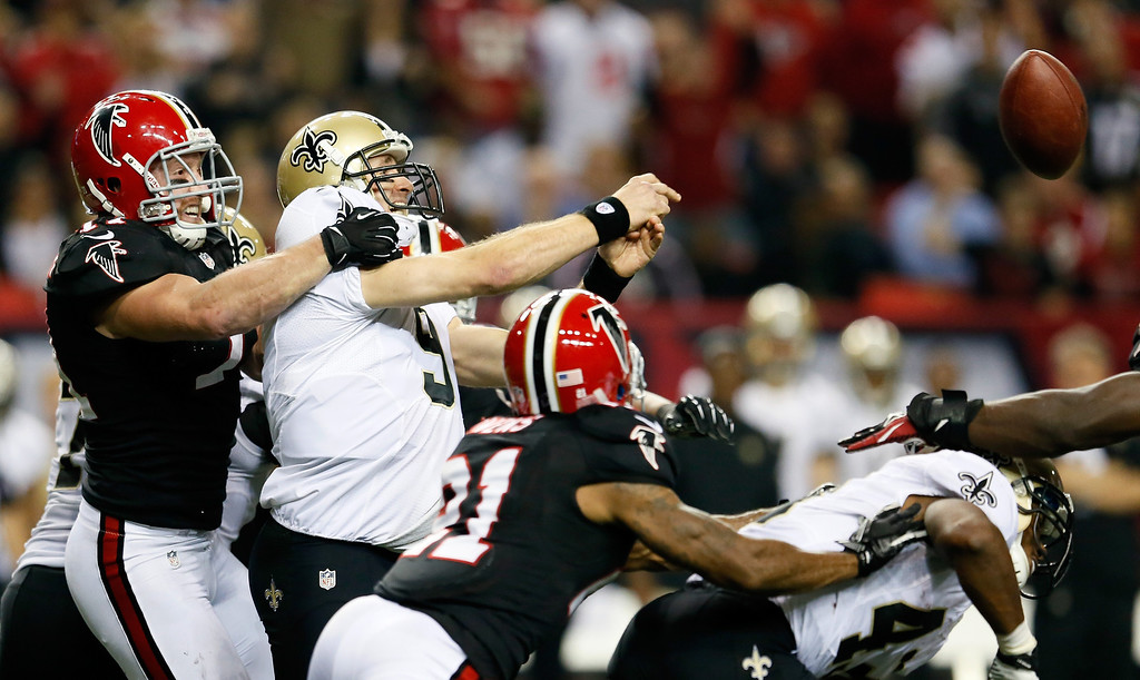 . ATLANTA, GA - NOVEMBER 29:  Kroy Biermann #71 of the Atlanta Falcons forces a interception by Drew Brees #9 of the New Orleans Saints at Georgia Dome on November 29, 2012 in Atlanta, Georgia.  (Photo by Kevin C. Cox/Getty Images)