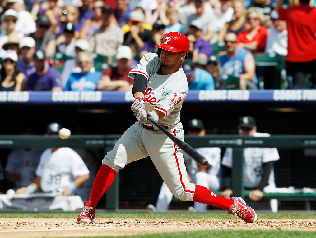 . Philadelphia Phillies\' Freddy Galvis pops out against the Colorado Rockies to end the top of the fifth inning of a baseball game in Denver on Sunday, June 16, 2013. (AP Photo/David Zalubowski)