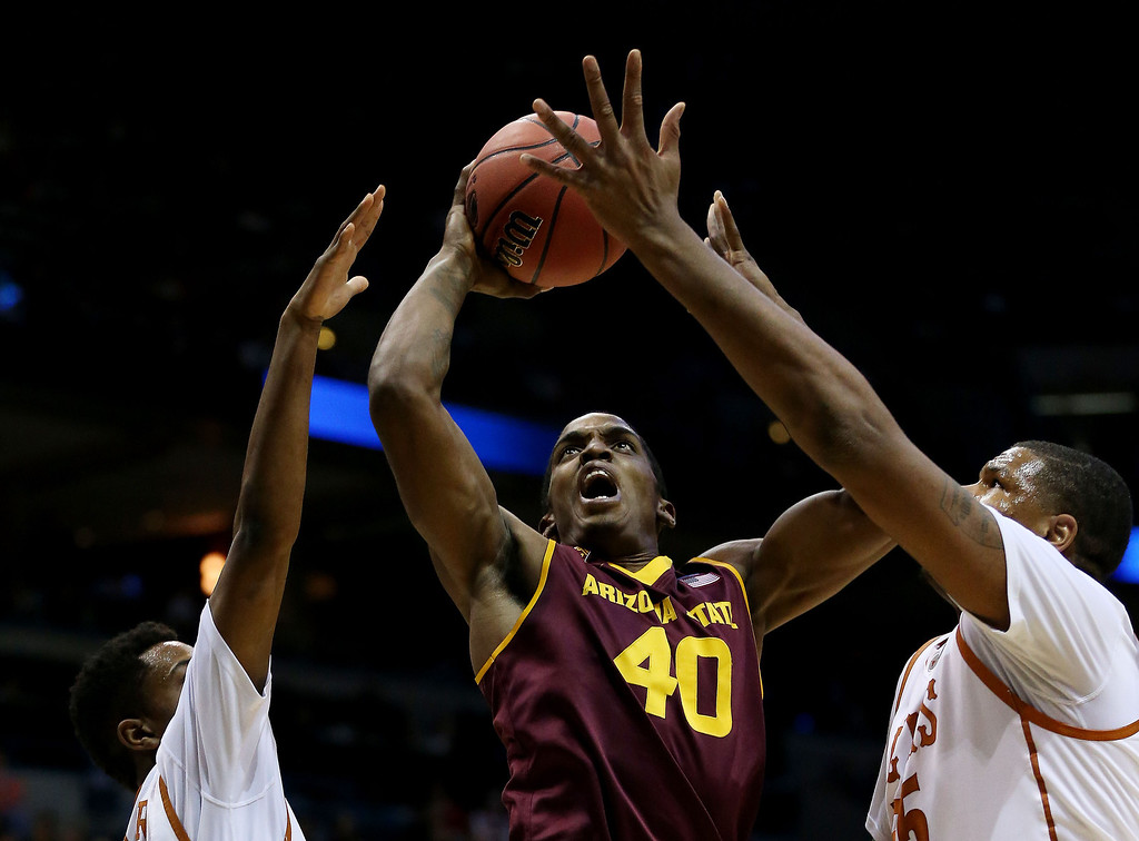 . Shaquielle McKissic #40 of the Arizona State Sun Devils shoots against Cameron Ridley #55 and Isaiah Taylor #1 of the Texas Longhorns in the first half during the second round of the 2014 NCAA Men\'s Basketball Tournament at BMO Harris Bradley Center on March 20, 2014 in Milwaukee, Wisconsin.  (Photo by Jonathan Daniel/Getty Images)
