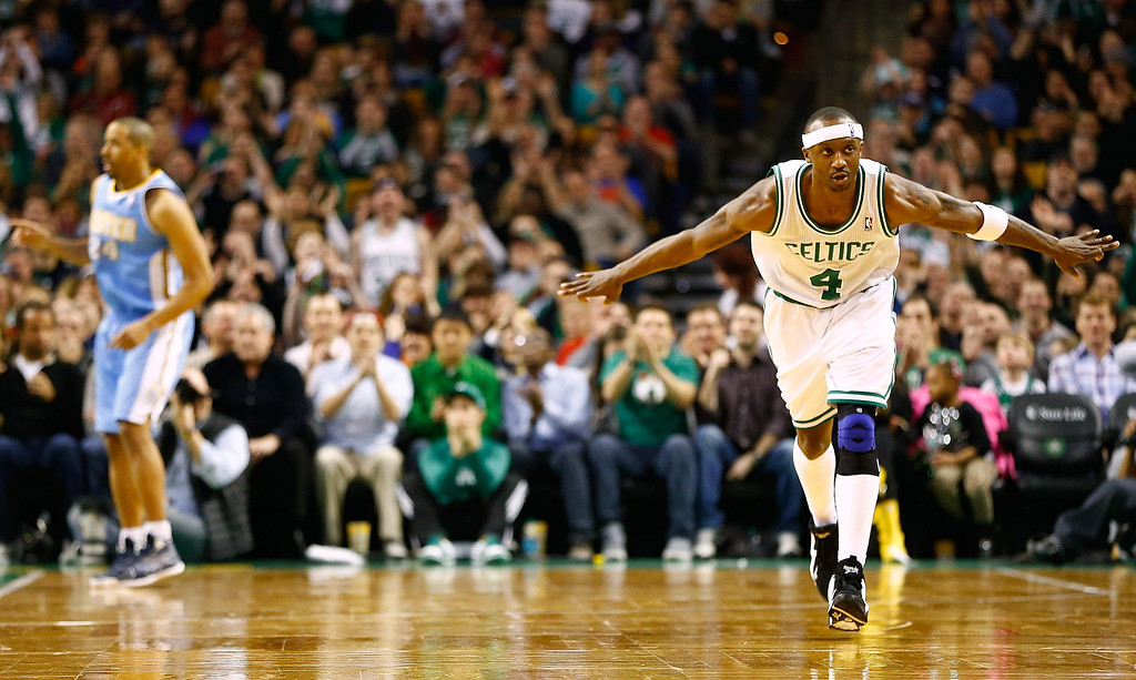 . BOSTON, MA - FEBRUARY 10: Jason Terry #4 of the Boston Celtics celebrates after making a three-point shot against the Denver Nuggets during the game on February 10, 2013 at TD Garden in Boston, Massachusetts.  (Photo by Jared Wickerham/Getty Images)