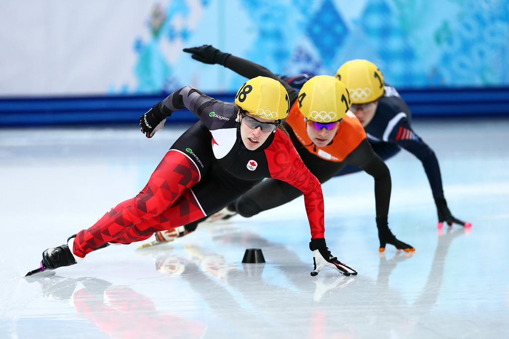 . SOCHI, RUSSIA - FEBRUARY 13:  Marianne St. Gelais of Canada, Yara van Kerkhof of the Netherlands, Seung-Hi Park of Korea, Charlotte Gilmartin of Great Britain compete in the Short Track Speed Skating Women\'s 500m heats on day 6 of the Sochi 2014 Winter Olympics at at Iceberg Skating Palace on February 13, 2014 in Sochi, Russia.  (Photo by Clive Mason/Getty Images)