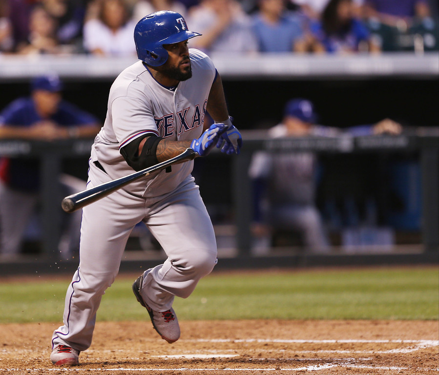 . Texas Rangers\' Prince Fielder breaks from the batter\'s box after singling against the Colorado Rockies in the fourth inning of an interleague baseball game in Denver on Monday, May 5, 2014. (AP Photo/David Zalubowski)