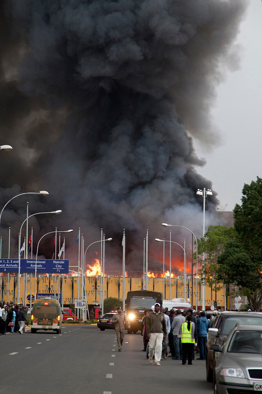 . Black smoke billows from the Jomo Kenyatta International Airport in Nairobi, Kenya Wednesday, Aug. 7, 2013. The Kenya Airports Authority said the Kenya\'s main international airport has been closed until further notice so that emergency teams can battle the fire. (AP Photo/Sayyid Azim)