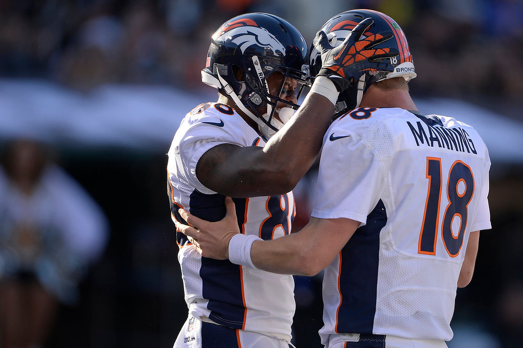 . Wide receiver Demaryius Thomas (88) and quarterback Peyton Manning (18) of the Denver Broncos celebrate a 65 yard touchdown pass to break the season yardage record against the Oakland Raiders at O.co Coliseum December 29, 2013 Oakland, CA. (Photo By Joe Amon/The Denver Post)