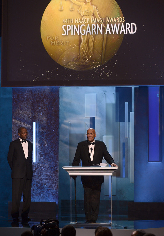 . LOS ANGELES, CA - FEBRUARY 01:  Actor Sidney Poitier (L) looks on as honoree Harry Belafonte accepts the Spingarn Medal during the 44th NAACP Image Awards at The Shrine Auditorium on February 1, 2013 in Los Angeles, California.  (Photo by Kevin Winter/Getty Images for NAACP Image Awards)