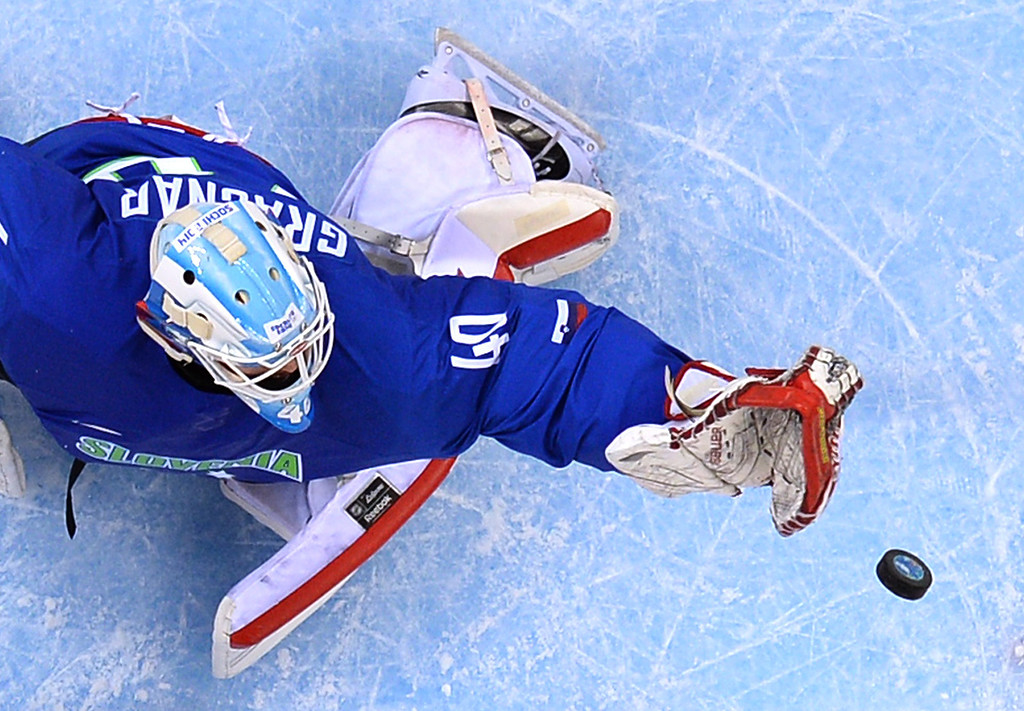 . Slovenia\'s goalkeeper Luka Gracnar defends the goal during the Men\'s Ice Hockey Group A match between Slovenia and USA at the Shayba Arena during the Sochi Winter Olympics on February 16, 2014.  JONATHAN NACKSTRAND/AFP/Getty Images