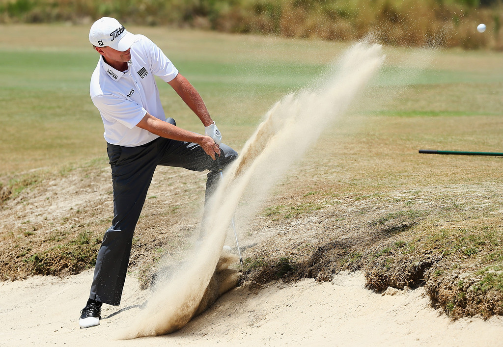 . Steve Stricker of the United States hits a shot from a greenside bunker on the third hole during the final round of the 114th U.S. Open at Pinehurst Resort & Country Club, Course No. 2 on June 15, 2014 in Pinehurst, North Carolina.  (Photo by Andrew Redington/Getty Images)
