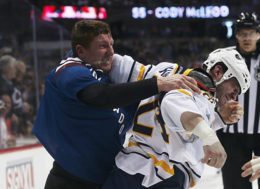 . Colorado Avalanche left wing Cody McLeod, left, fights with Buffalo Sabres center Zenon Konopka in the third period of the Avalanche\'s 7-1 victory in an NHL hockey game in Denver,2 Saturday, Feb. 1, 2014. (AP Photo/David Zalubowski)