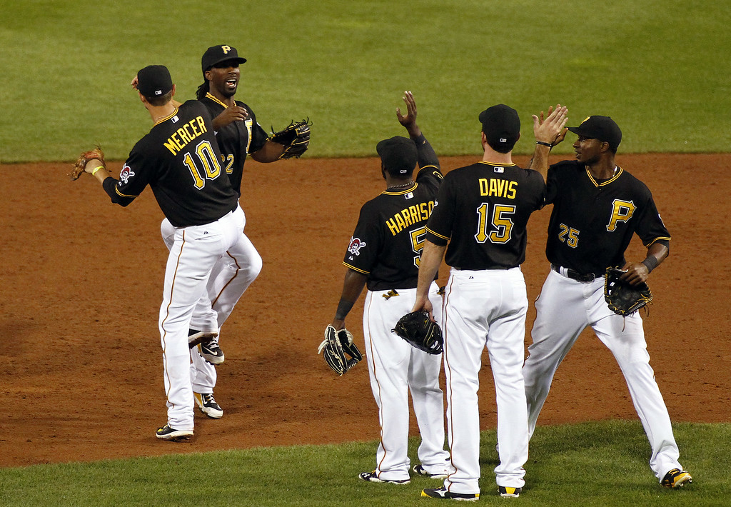 . PITTSBURGH, PA - JULY 18:  Andrew McCutchen #22 of the Pittsburgh Pirates celebrates with teammates after defeating the Colorado Rockies 4-2 at PNC Park July 18, 2014 in Pittsburgh, Pennsylvania.  (Photo by Justin K. Aller/Getty Images)