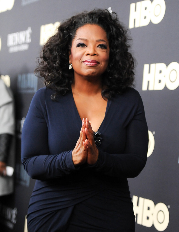 """. Oprah Winfrey attends the premiere of \""""Beyonce: Life Is But A Dream\"""" at the Ziegfeld Theatre on Tuesday, Feb. 12, 2013 in New York. (Photo by Evan Agostini/Invision/AP)"""