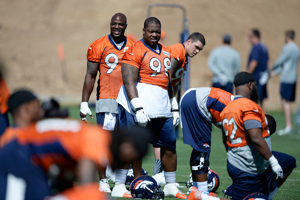. Denver Broncos defensive end DeMarcus Ware (94) and Terrence Knighton (98) looks on during stretching at OTAs June 2, 2014 at Dove Valley. (Photo by John Leyba/The Denver Post)