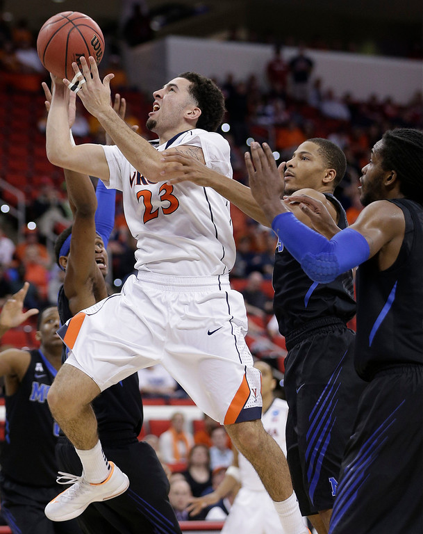 . Virginia guard London Perrantes (23) shoots against Memphis during the second half of an NCAA college basketball third-round tournament game, Sunday, March 23, 2014, in Raleigh, N.C. (AP Photo/Chuck Burton)