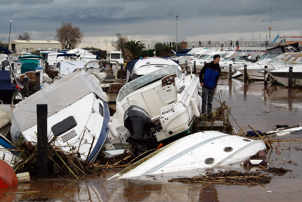 . Motor boats sank after a flooding, in the port of La Londe Les Maures, near Toulon, southern France, Monday, Jan. 20, 2014, after unusually heavy rains flooded the French Riviera, leaving two people dead and some thousands without electricity or access to roads. The administration for the Var region evacuated some residents and urged others to stay indoors until the waters recede. (AP Photo/Claude Paris)