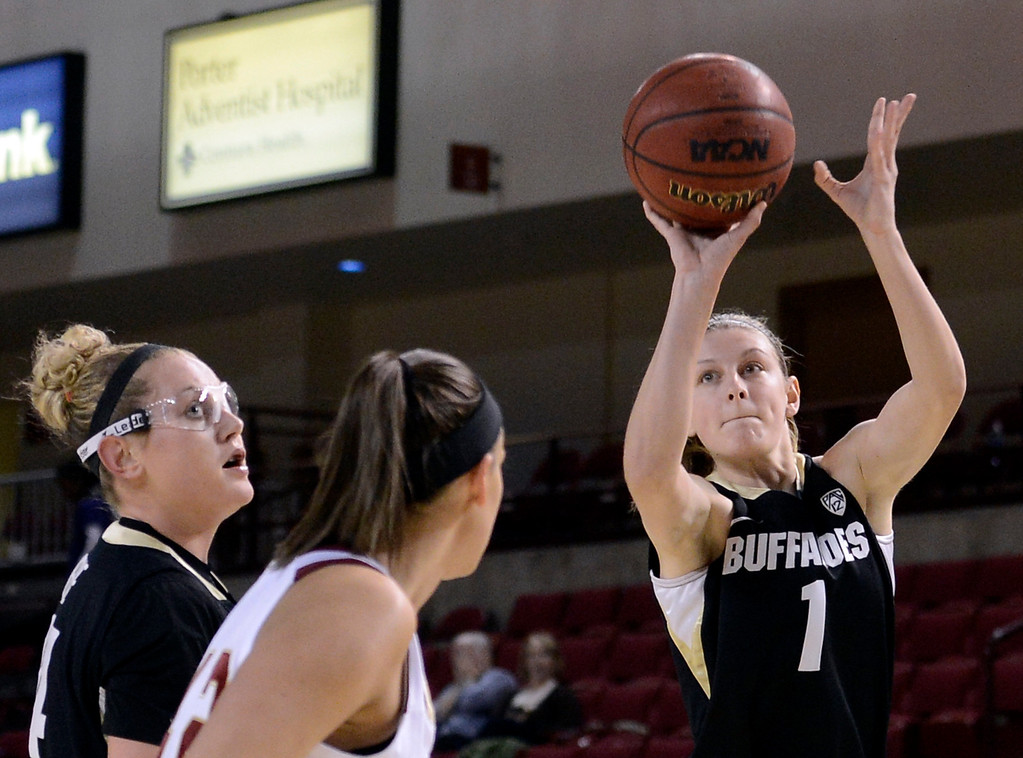 . University of Colorado\'s Lexy Kresl shoots a three-pointer in front of Alison Janecek during a games against the University of Denver on Tuesday, Dec. 11, at the Magnus Arena on the DU campus in Denver.  (Jeremy Papasso/Daily Camera)
