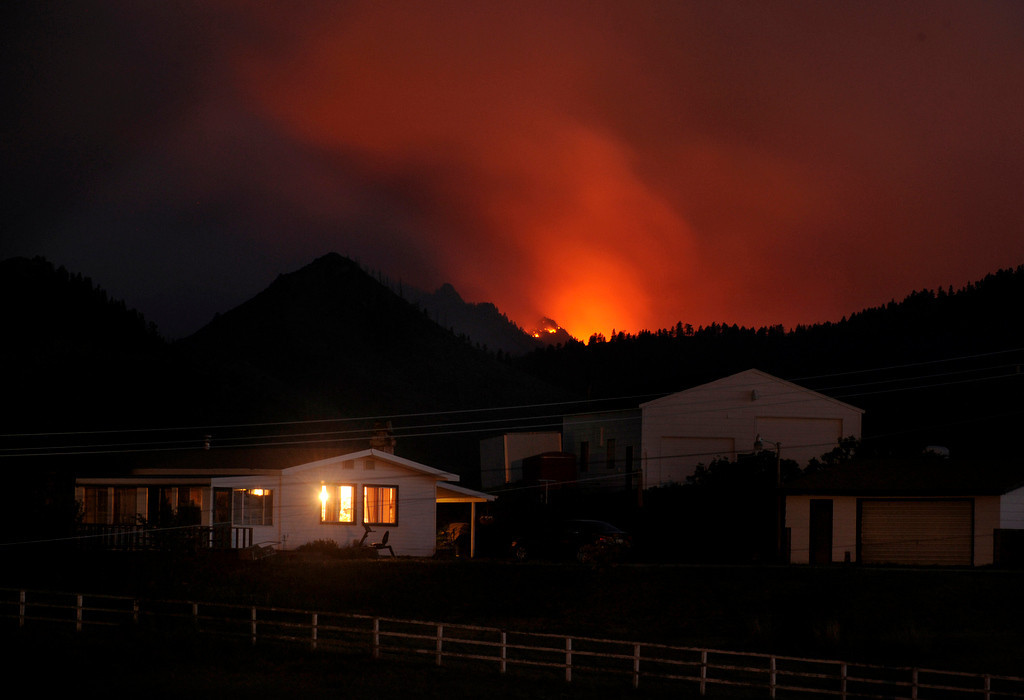 . Flames illuminated the smoke rising into the air west of Livermore, Colorado Friday night, June 22, 2012. The High Park fire crossed the Poudre River again Friday threatening homes to the north. Karl Gehring/The Denver Post