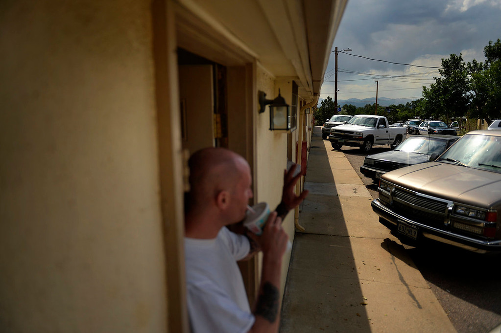 . Commerce City police and parole officers arrive at the Triangle T Motel to search a room across the parking lot from 35 year old parolee Thomas Vescio on his first day on parole on July 09, 2013 in Commerce City, Colorado.  (Photo By Joe Amon/The Denver Post)