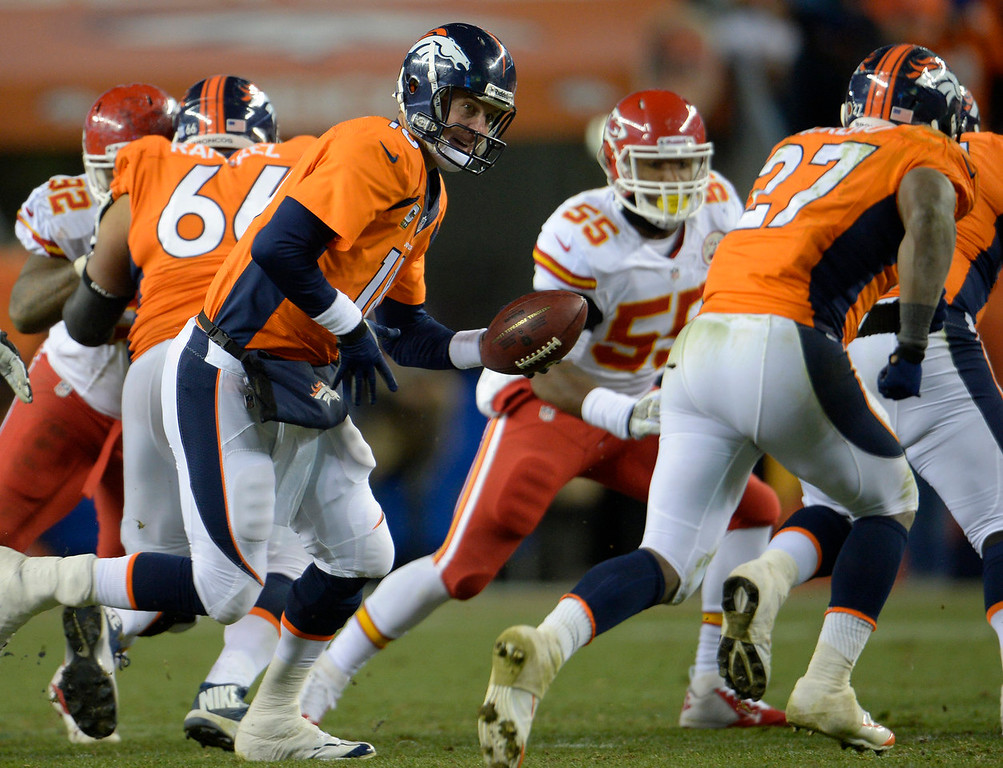 . Denver Broncos quarterback Peyton Manning (18) hands off to Denver Broncos running back Knowshon Moreno (27) during the fourth quarter. The Denver Broncos vs. the Kansas City Chiefs at Sports Authority Field at Mile High in Denver on November 17, 2013. (Photo by Joe Amon/The Denver Post)