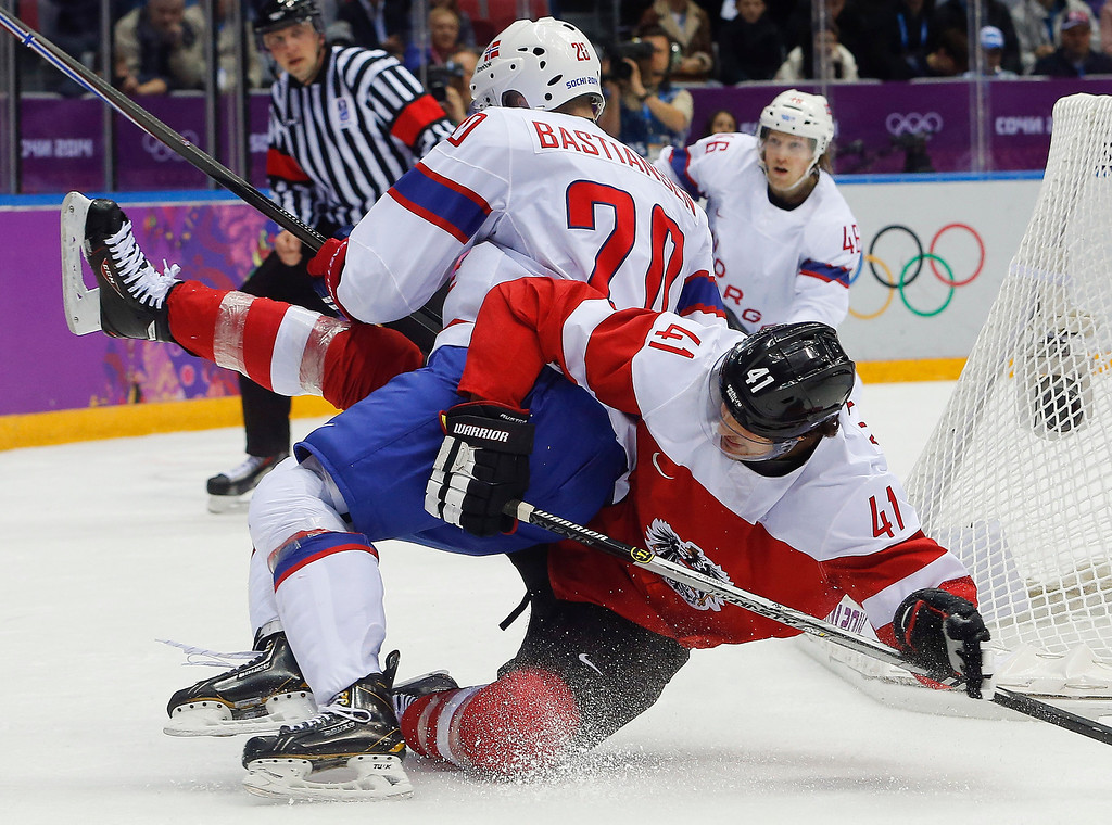 . Norway forward Anders Bastiansen (20) gets tangled up with Austria defenseman Mario Altmann in the second period of a men\'s ice hockey game at the 2014 Winter Olympics, Sunday, Feb. 16, 2014, in Sochi, Russia. (AP Photo/Mark Humphrey)