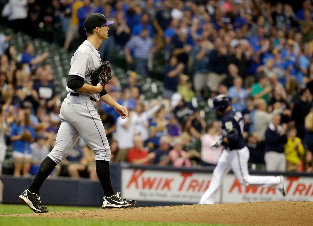 . Colorado Rockies starting pitcher Christian Friedrich walks back to the mound after giving up a two-run home run to Milwaukee Brewers\' Aramis Ramirez during the first inning of a baseball game Thursday, June 26, 2014, in Milwaukee. (AP Photo/Morry Gash)