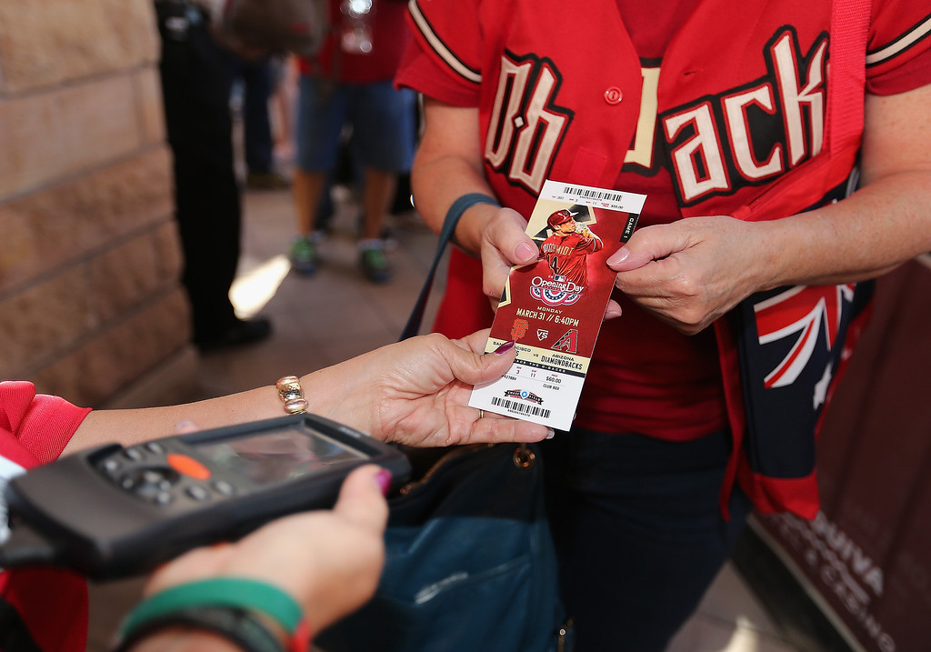 . An Arizona Diamondbacks fan has her ticket scanned as she arrives to the Opening Day MLB game against the San Francisco Giants at Chase Field on March 31, 2014 in Phoenix, Arizona.  (Photo by Christian Petersen/Getty Images)