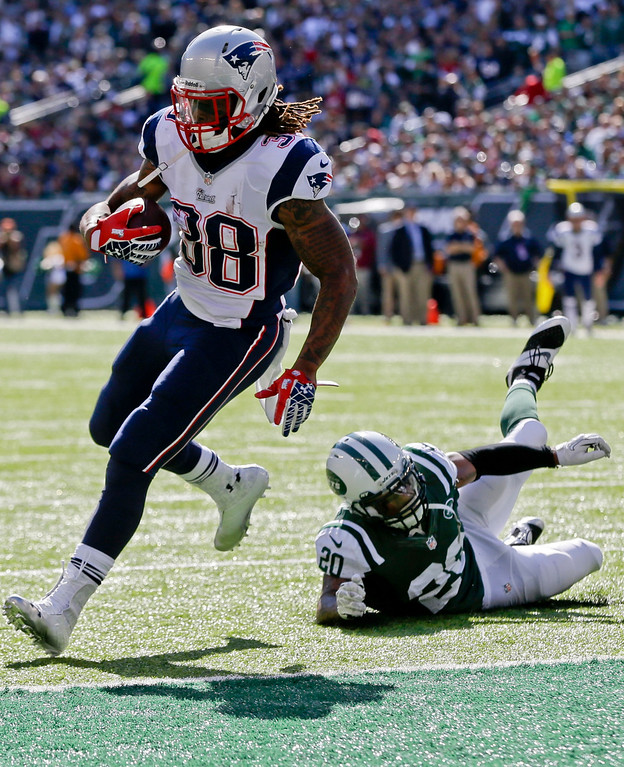 . New England Patriots\' Brandon Bolden (38) runs away from New York Jets\' Kyle Wilson (20) for a touchdown during the first half of an NFL football game Sunday, Oct. 20, 2013 in East Rutherford.  (AP Photo/Seth Wenig)