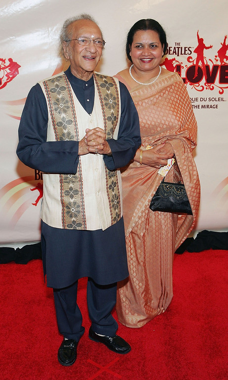 ". FILE - DECEMBER 11: Sitar player Ravi Shankar has died at 92. LAS VEGAS - JUNE 30: Indian musician Ravi Shankar (L) and his wife Sukanya arrive at the gala premiere of ""The Beatles LOVE by Cirque du Soleil\"" at the Mirage Hotel & Casino June 30, 2006 in Las Vegas, Nevada. The show is a joint artistic venture between The Beatles\' company, Apple Corps Ltd., and Cirque du Soleil.  (Photo by Ethan Miller/Getty Images)"