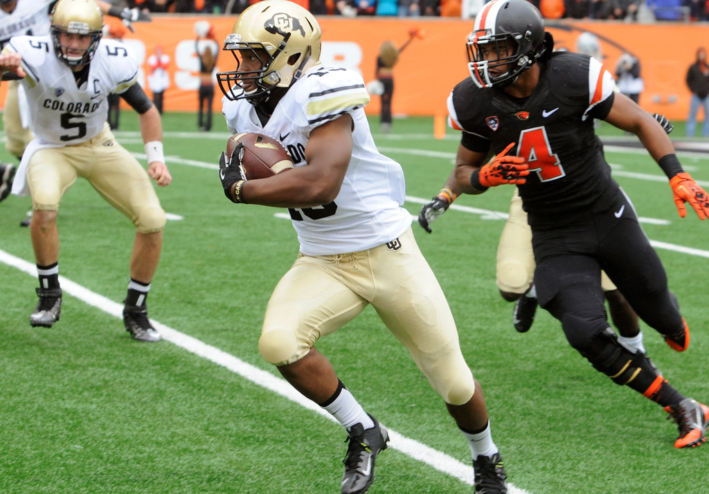 . Oregon State\'s D.J. Alexander (4) chases Colorado\'s Michael Adkins (19) in the first half of an NCAA college football game on Saturday, Sept 28, 2013, in Corvallis, Ore. (AP Photo/Greg Wahl-Stephens)