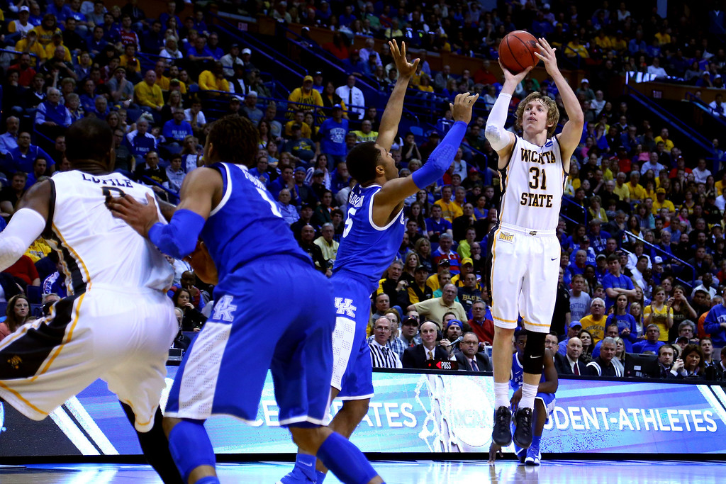 . Ron Baker #31 of the Wichita State Shockers shoots the ball against the Kentucky Wildcats during the third round of the 2014 NCAA Men\'s Basketball Tournament at Scottrade Center on March 23, 2014 in St Louis, Missouri.  (Photo by Dilip Vishwanat/Getty Images)