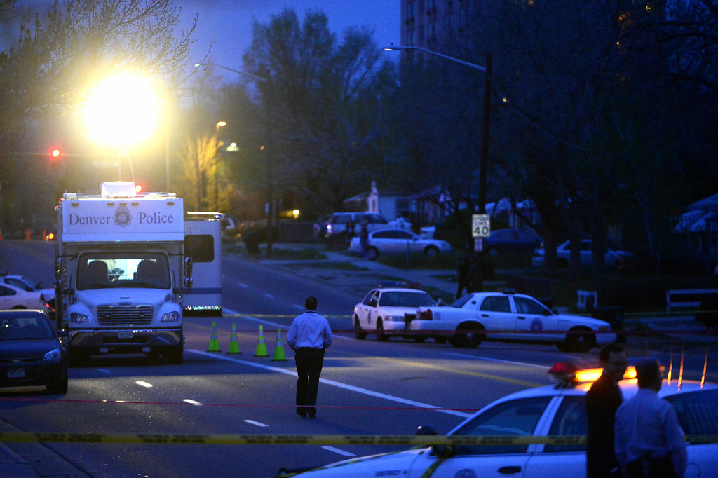 . DENVER, CO - MAY 14: Police investigate the scene of an officer-involved shooting near the intersection of Harvard and Federal Boulevard. (Photo by AAron Ontiveroz/The Denver Post)