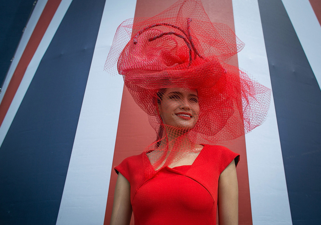 . Racegoer Jin Ye from China poses for a photograph on June 19, 2014 in London, England. The Royal Ascot horse race meeting runs from June 17 2014, until June 21 2014, and has taken place since 1711.  (Photo by Matt Cardy/Getty Images)