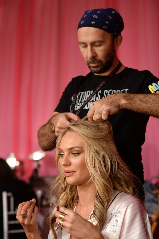 . Model Candice Swanepoel poses at the 2013 Victoria\'s Secret Fashion Show hair and make-up room at Lexington Avenue Armory on November 13, 2013 in New York City.  (Photo by Dimitrios Kambouris/Getty Images for Victoria\'s Secret)