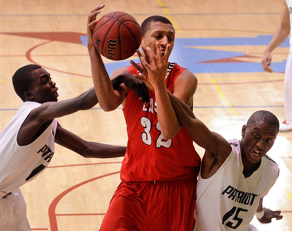 . DENVER, CO. - FEBRUARY 16: Angels forward Tyre Robinson (32) was double-teamed as he tried to haul in a rebound in the first half. The Denver East High School boy\'s basketball team defeated George Washington 82-20 Saturday afternoon, February 16, 2013.  (Photo By Karl Gehring/The Denver Post)