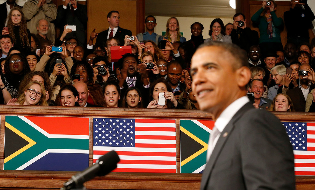 . The audience reacts as U.S. President Barack Obama delivers remarks at the University of Cape Town in South Africa on June 30, 2013.  REUTERS/Jason Reed