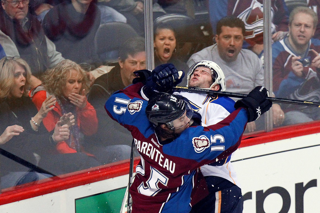. Colorado Avalanche\'s P.A. Parenteau (15) high-sticks St. Louis Blues\' David Backes (42) as he protects teammate Jamie McGinn (11), who Backes slammed into the boards, during the third period of an NHL hockey game, Sunday, April 21, 2013, in Denver. The Avalanche won 5-3. (AP Photo/Barry Gutierrez)
